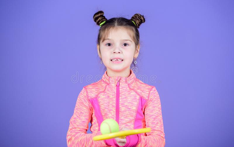 Come to watch me play. Sport training for kids. Cute tennis player. Little girl child in sport club. Sport and leisure royalty free stock photography