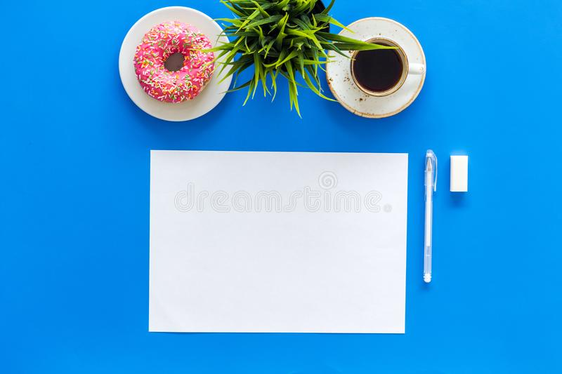 Come up with brand identity. Blank stationery for branding near coffee and donut on blue background top view mockup stock image