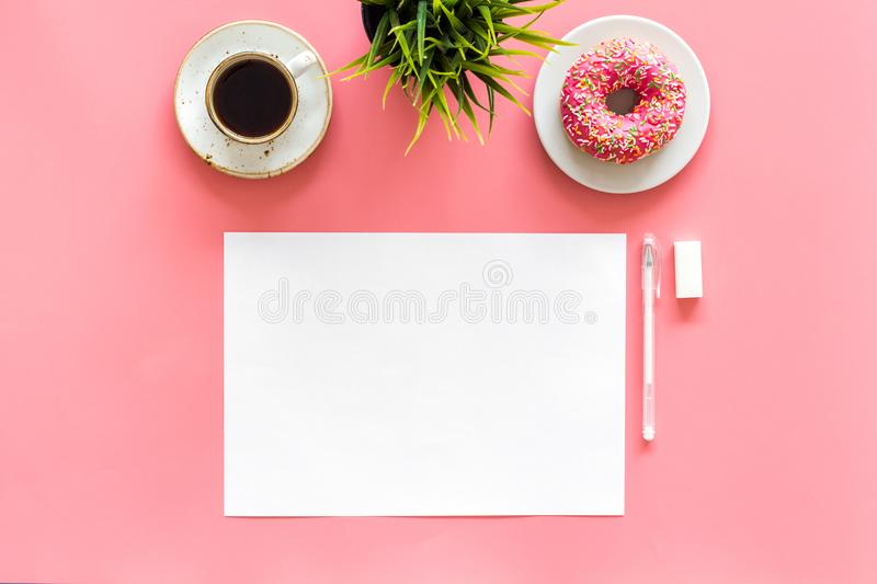 Come up with brand identity. Blank stationery for branding near coffee and donut on pink background top view mockup stock images