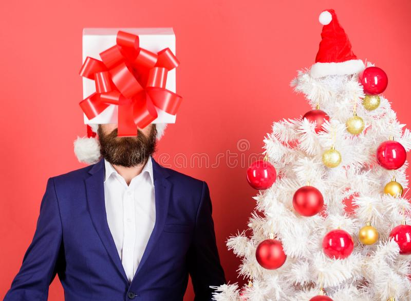 Come up with good present. Gift service. Head downtrodden with thoughts what to gift. Man bearded formal suit carry gift. Box on head. Christmas present idea stock images