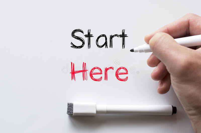 Comece escrito aqui no whiteboard fotos de stock royalty free