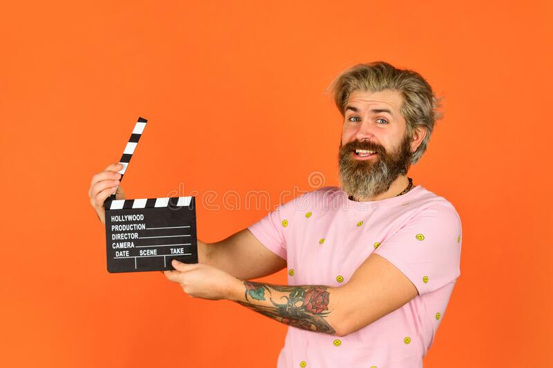 Comedy or drama. Watch movie. Film director. Actor casting. Shooting scene. Favorite series. Cinema production. Creative. Producer. Bearded man hold movie royalty free stock photo
