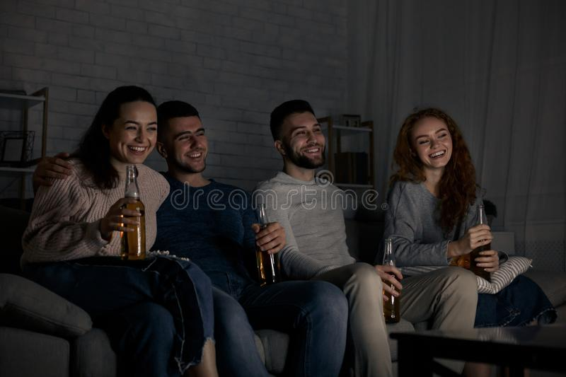 Comedy film. Happy friends watching movie at home. Together stock images
