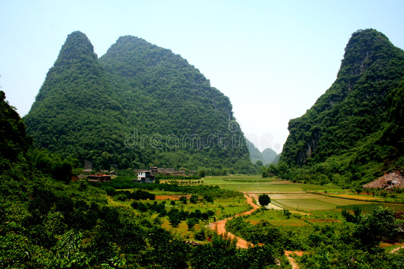 Comely Guilin hills and paddy. Beatiful guilin paddy field with hills and peaks surrouded royalty free stock photos