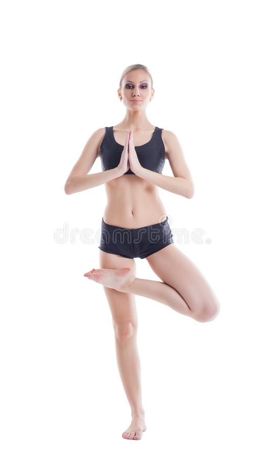 Comely young woman posing meditating at camera. Isolated on white stock image