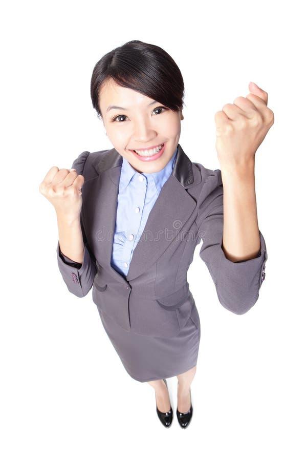 Comemoração da mulher de negócio do sucesso foto de stock