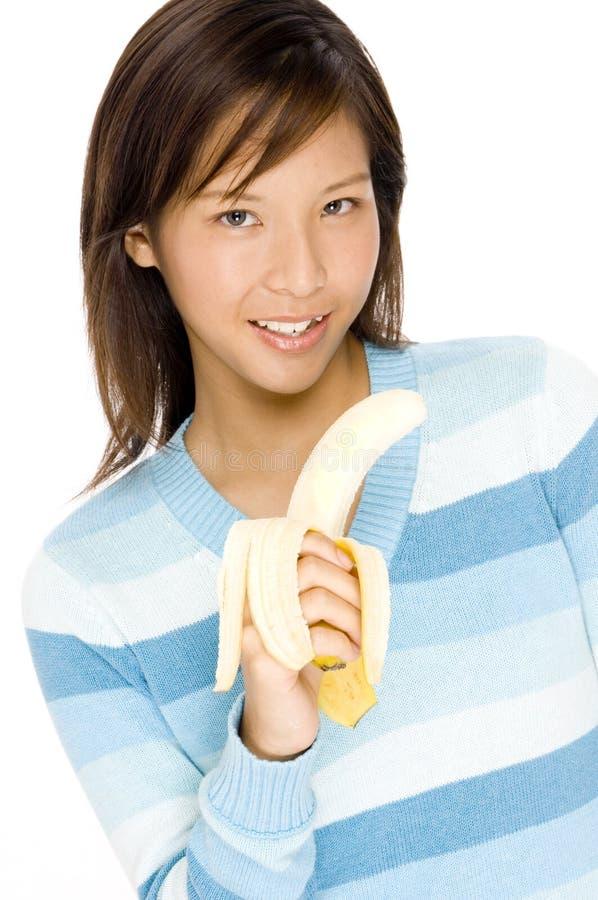 Comendo a banana imagem de stock royalty free