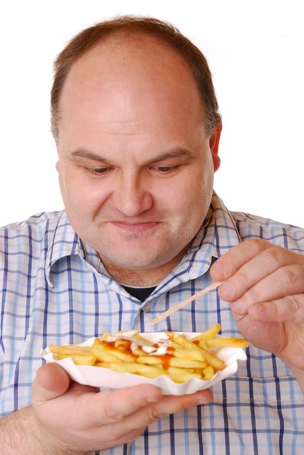 Comendo fritadas do francês fotografia de stock