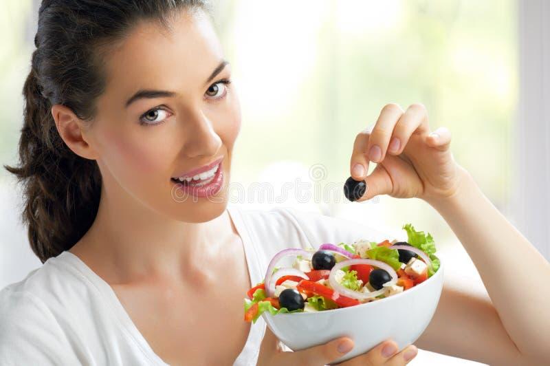 Comendo o alimento saudável fotografia de stock