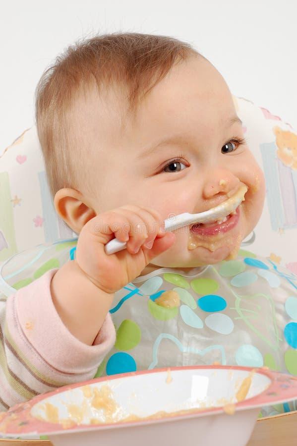 Comendo o bebé fotografia de stock