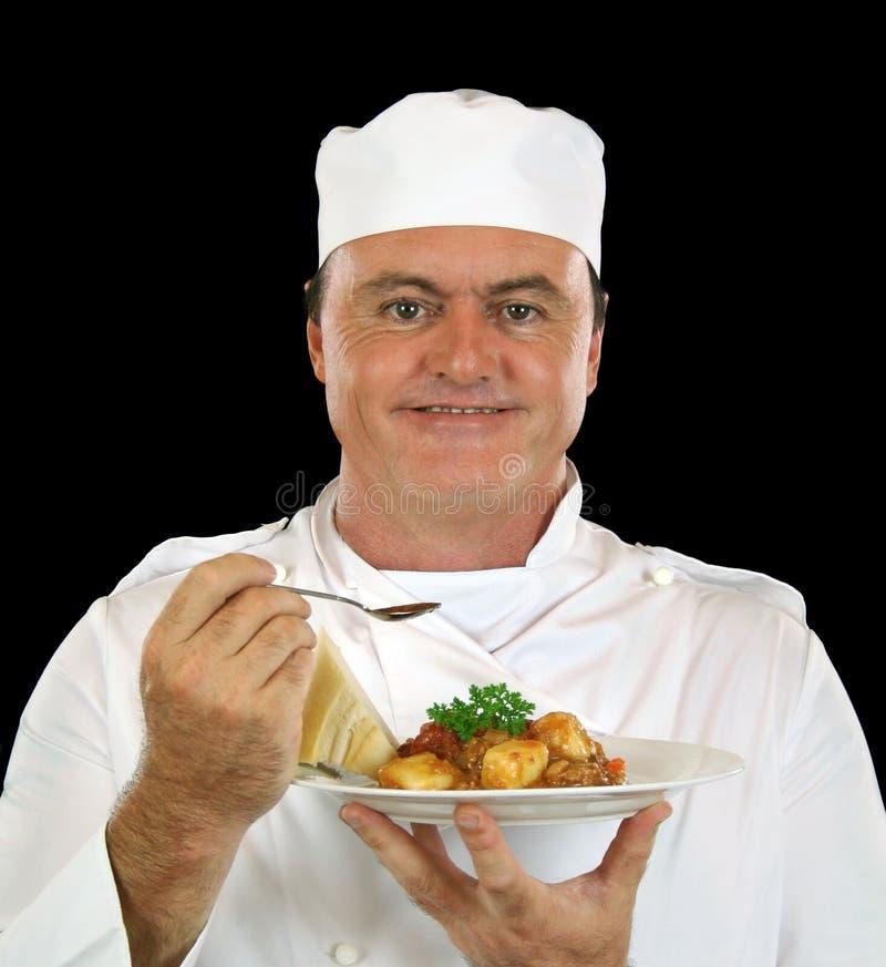 Comendo o cozinheiro chefe foto de stock royalty free