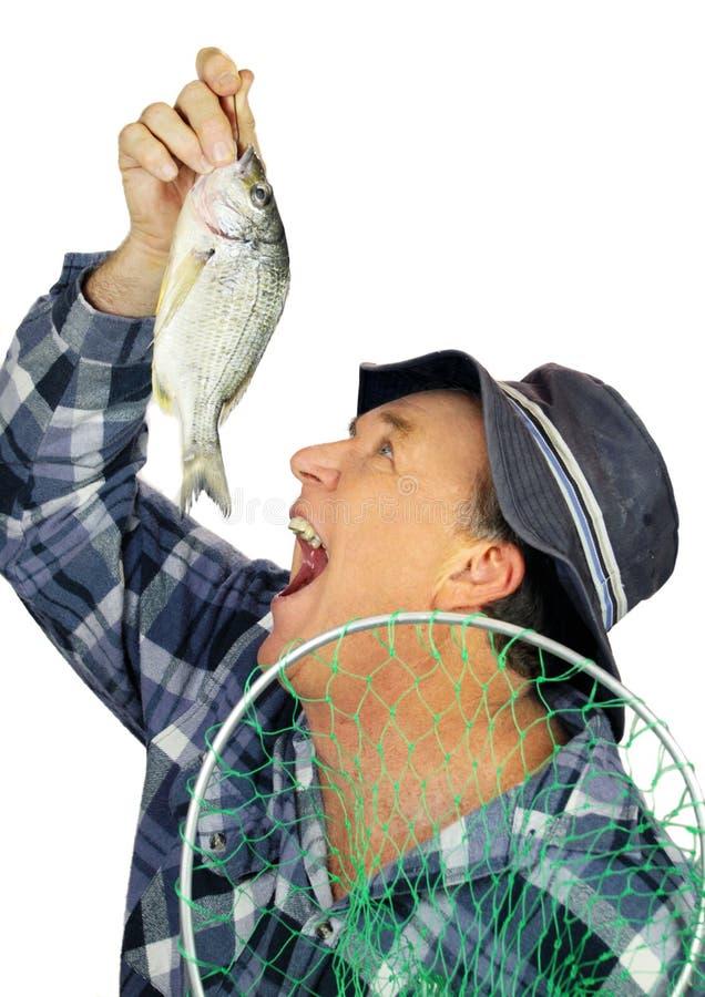 Comendo o pescador dos peixes foto de stock