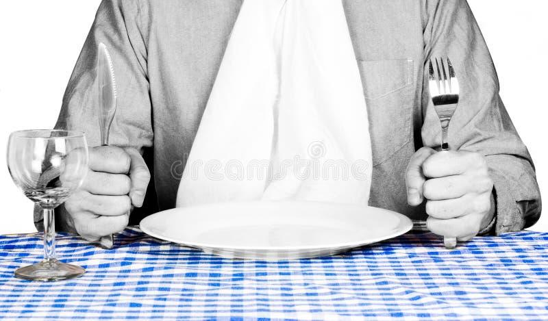Comensal que aguarda servicio de alimento. fotografía de archivo