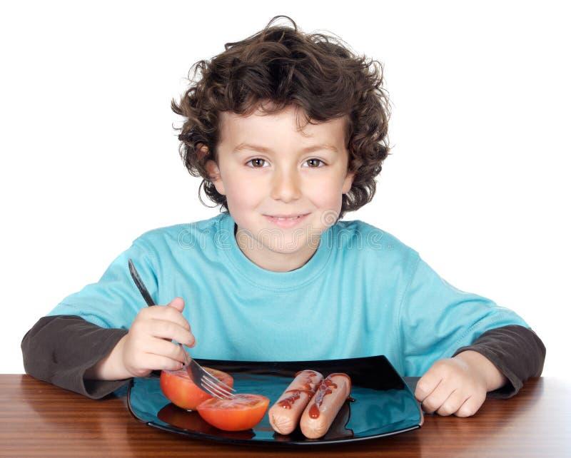 Comer adorável da criança imagens de stock royalty free
