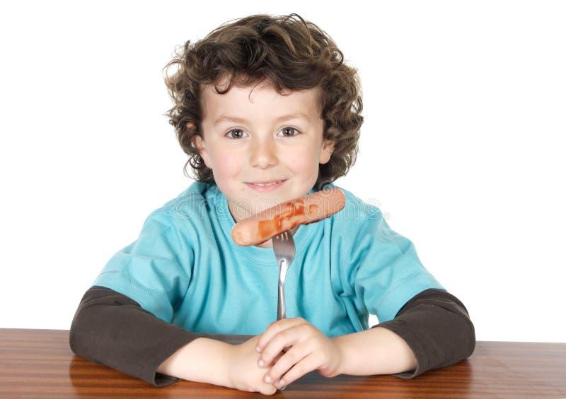 Comer adorável da criança fotografia de stock