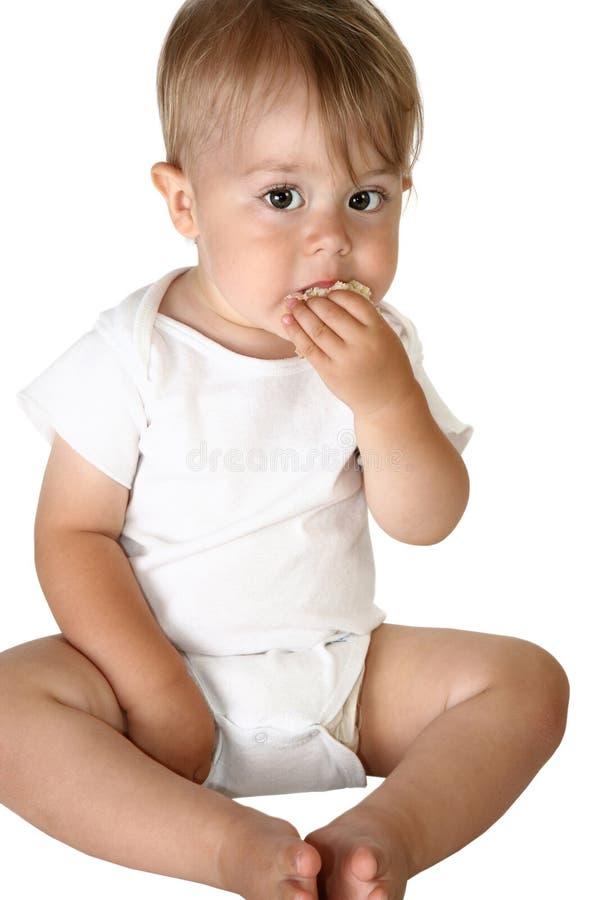 Comer adorável do bebé imagens de stock royalty free