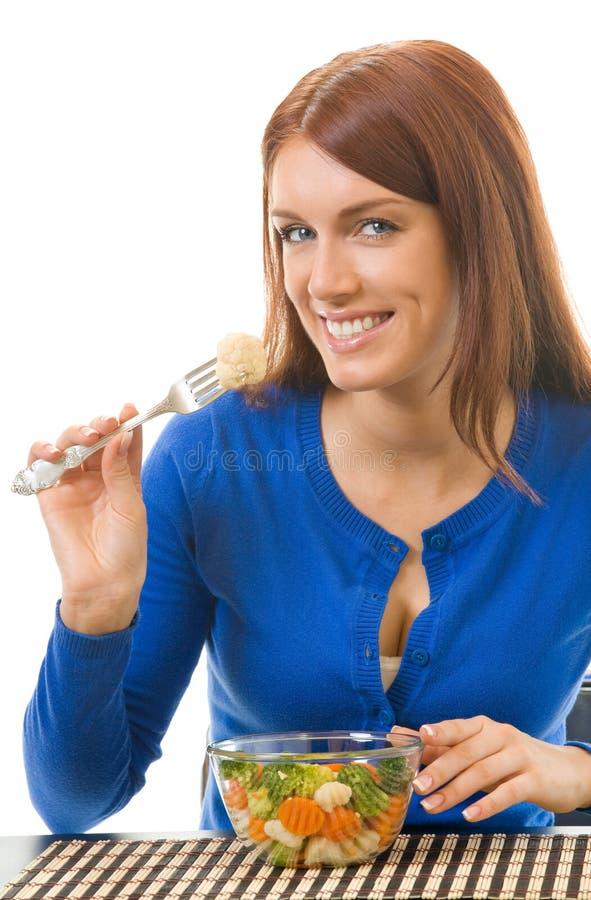 Comer da mulher nova fotos de stock
