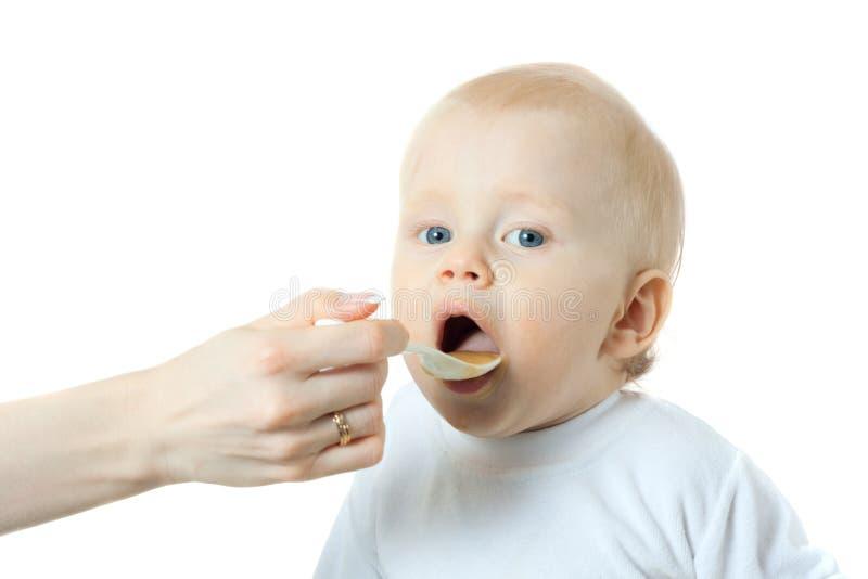 Comer do rapaz pequeno fotografia de stock royalty free