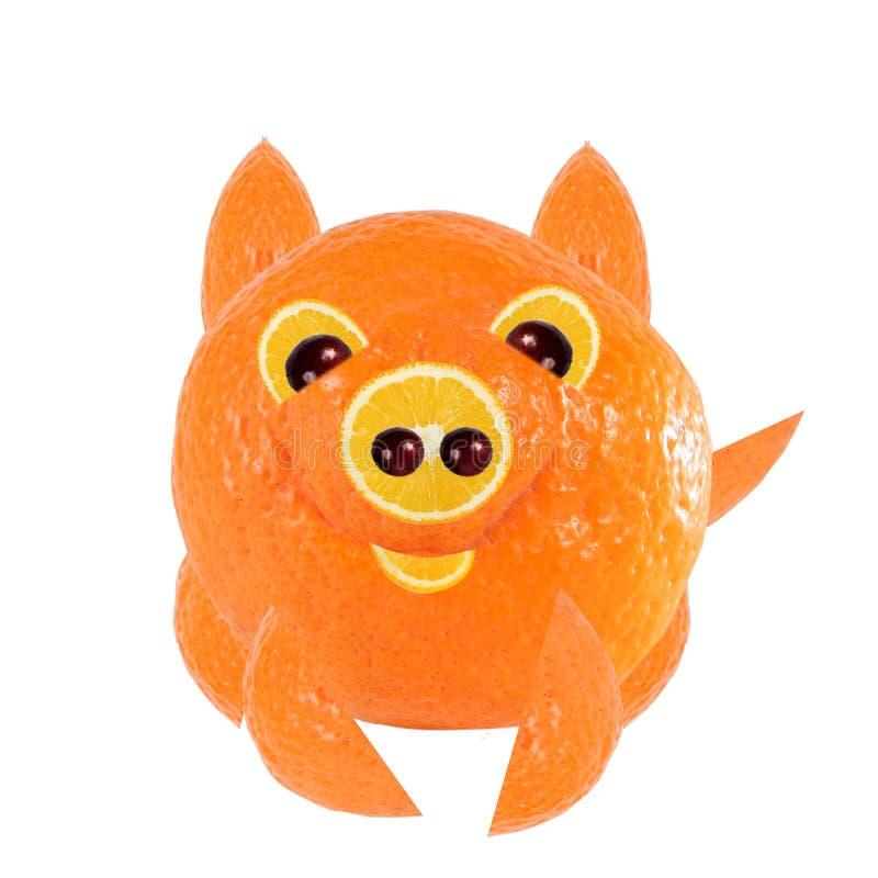 Comer saudável Porco pequeno, feito da laranja foto de stock royalty free