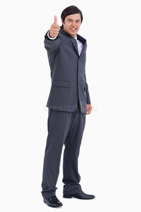 Comerciante que da el pulgar para arriba fotografía de archivo libre de regalías