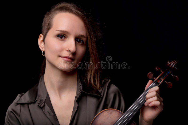 When it comes to music I`m serious. Violinist woman - portrait of a professional classical music player concept royalty free stock photos