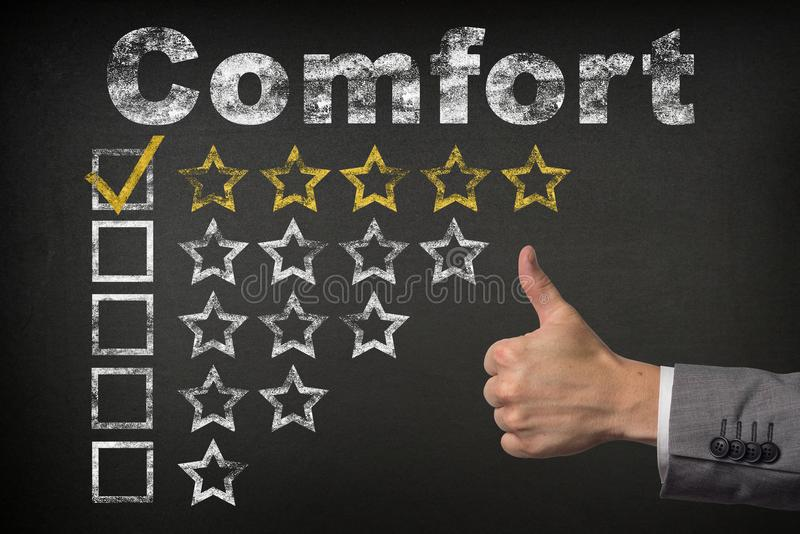 Comfort five 5 star rating. thumbs up service golden rating stars on chalkboard.  stock photography