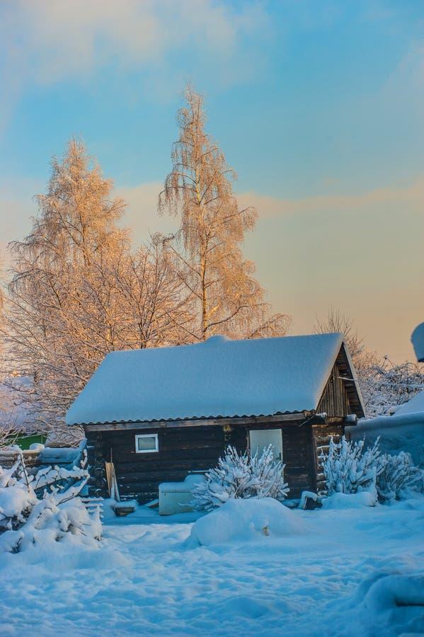 Comfortabel de winterhuis stock foto's