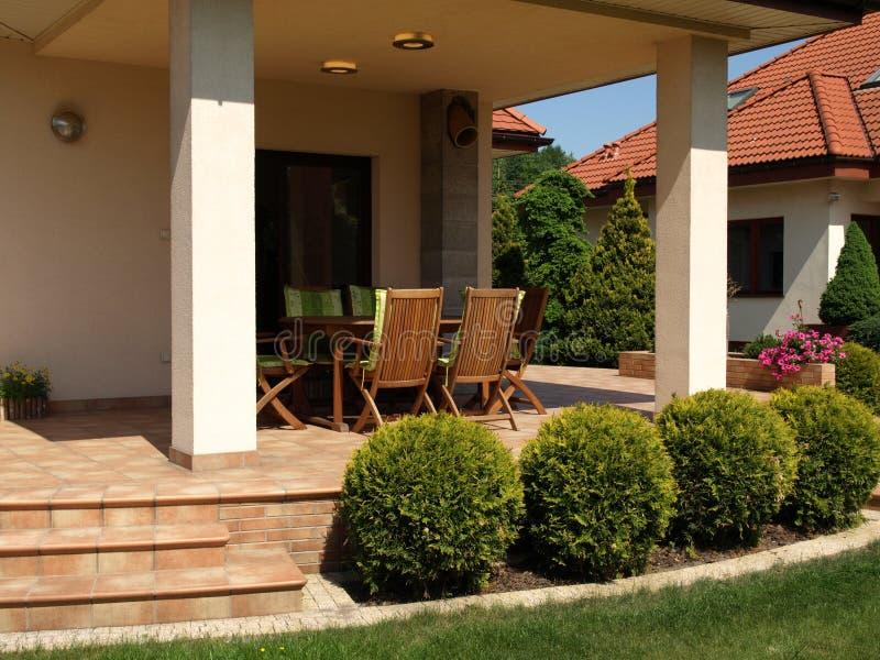 Comfortabel terras stock afbeeldingen