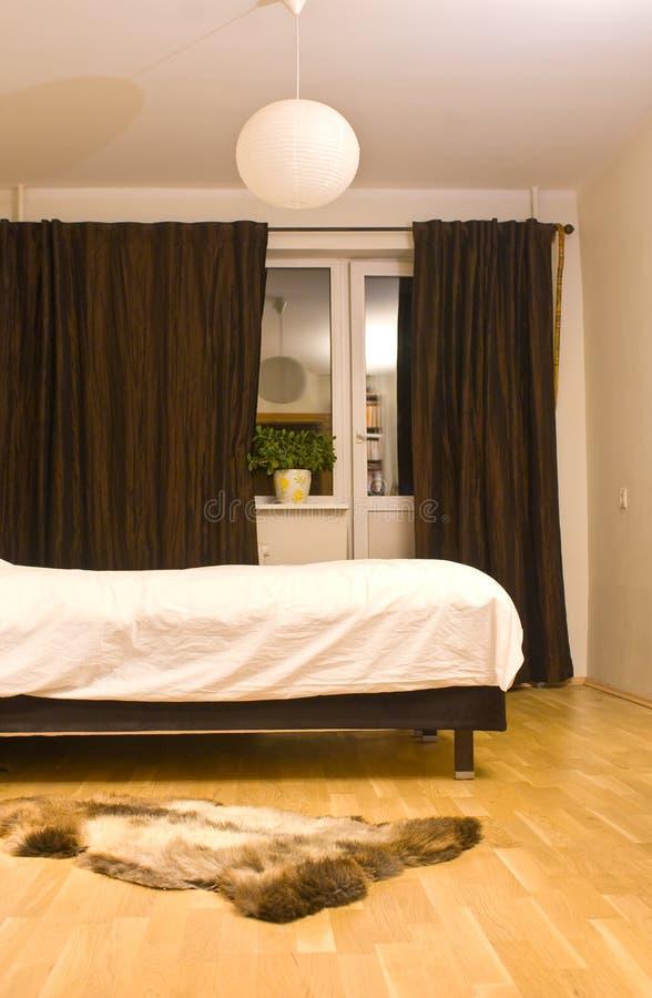 Comfortabele slaapkamer stock afbeeldingen
