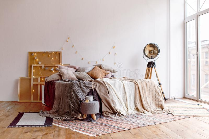 Bed in stylish room stock photography