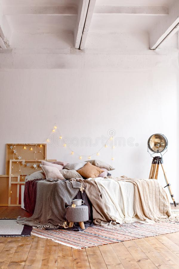 Bed in stylish room stock photos