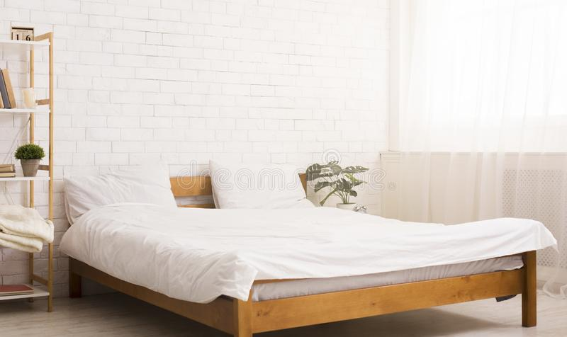 Comfortable bedroom interior with bed, empty space royalty free stock photography