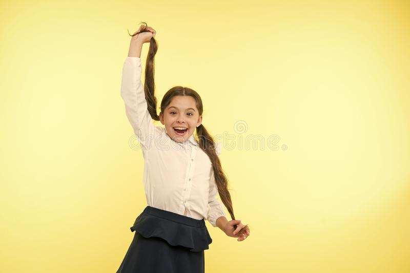 Comfortable and easy hairstyle. Deal with long hair hairstyle by yourself. Kid girl long ponytail hairstyle. Child stock photography