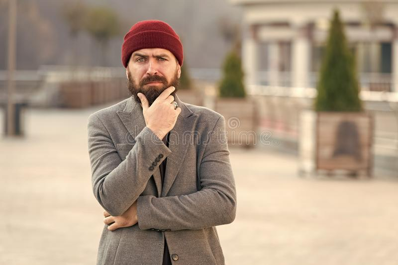 Comfortable with his style. Hipster outfit and hat accessory. Casual outfit spring season. Menswear and male fashion. Concept. Man bearded hipster stylish royalty free stock photo