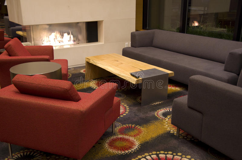 Comfortable hotel lobby with fireplace stock photography
