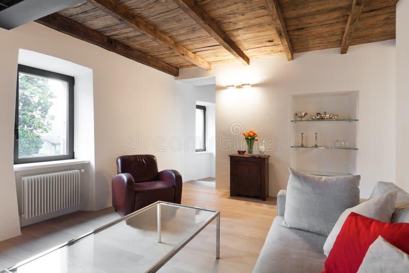 Comfortable loft furnished stock images