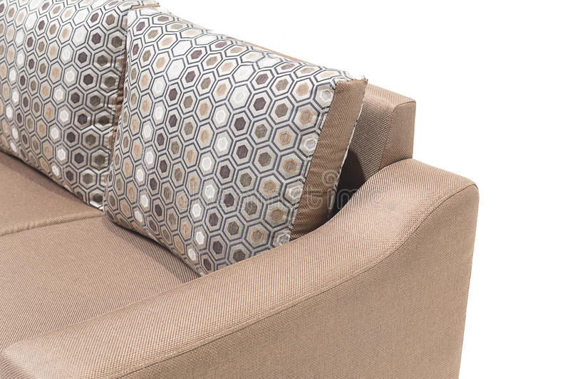Comfortable luxury sofa made of highest quality linen and leather in beige color. Comfortable luxury sofa made of highest quality with cushions royalty free stock image