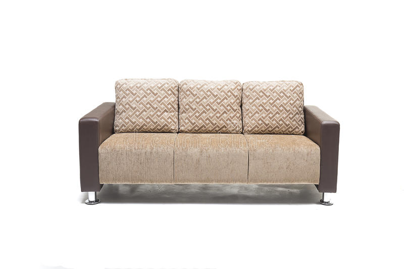 Comfortable luxury sofa made of highest quality linen and leather in beige color. Comfortable luxury sofa made of highest quality with cushions royalty free stock images