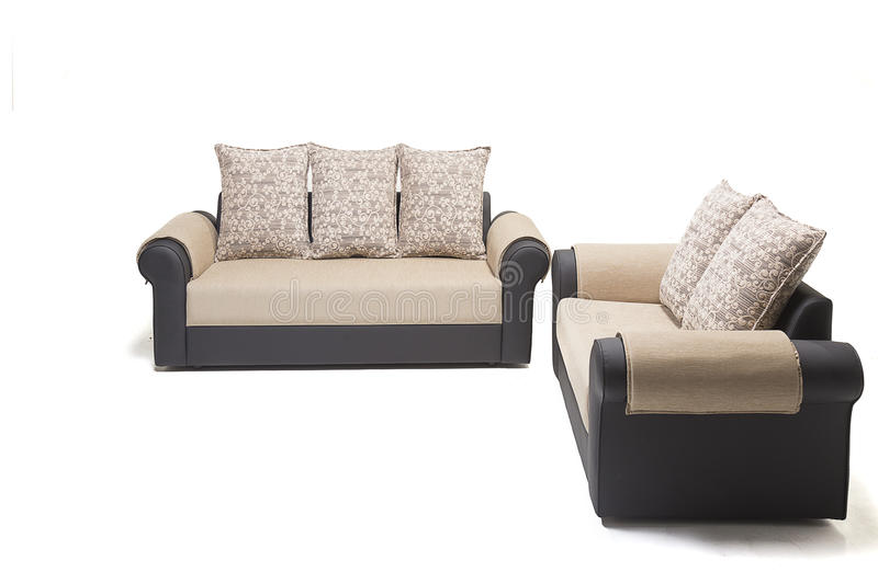 Comfortable luxury sofa set made of highest quality lenin and leather in beige color. Comfortable luxury sofa made of highest quality with cushions stock image