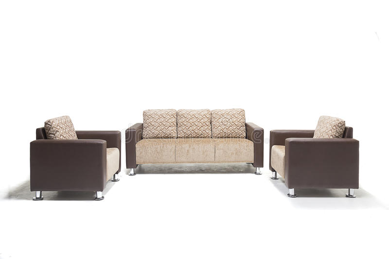Comfortable luxury sofa set made of highest quality lenin and leather in beige color. Comfortable luxury sofa made of highest quality with cushions royalty free stock photo