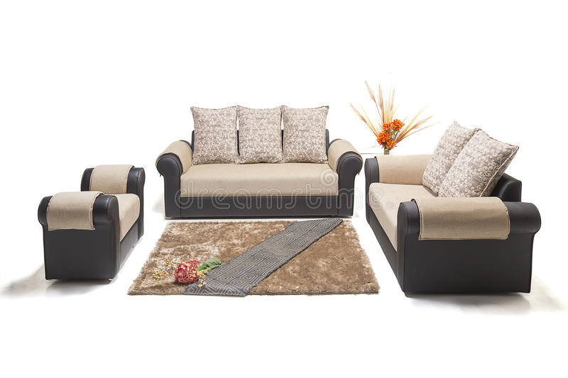 Comfortable luxury sofa set made of highest quality lenin and leather in beige color. Comfortable luxury sofa made of highest quality with cushions stock photo