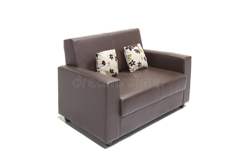 Comfortable luxury sofa set made of highest quality lenin and leather in beige color. Comfortable luxury sofa made of highest quality with cushions royalty free stock photos