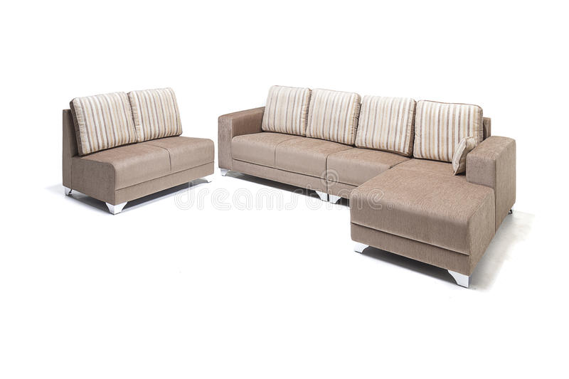 Comfortable luxury sofa set made of highest quality lenin and leather in beige color. Comfortable luxury sofa made of highest quality with cushions royalty free stock images