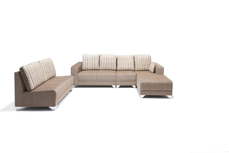 Comfortable luxury sofa set made of highest quality lenin and leather in beige color. Comfortable luxury sofa made of highest quality with out cushions stock images