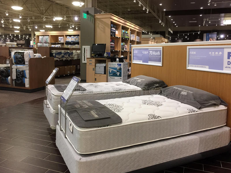 Comfortable mattress sale at furniture market stock image