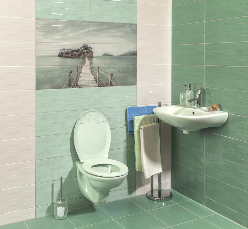 Comfortable modern bathroom. With green tiles royalty free stock image