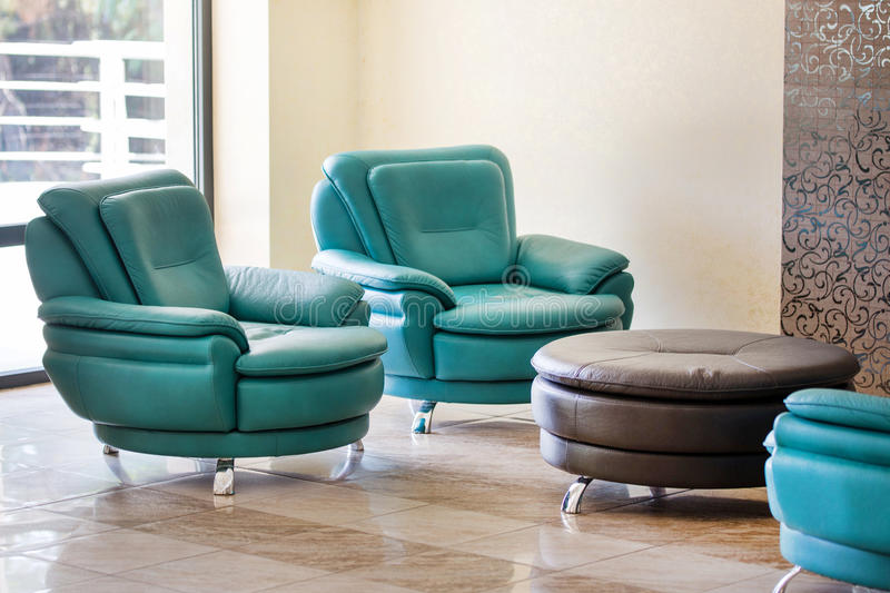 Comfortable modern luxury leather armchairs and round table royalty free stock image
