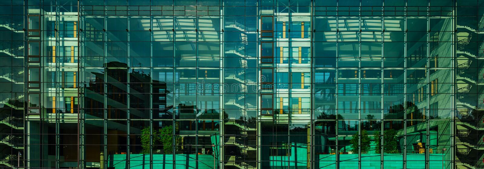 Comfortable office building panoramic view through the glass wall royalty free stock photography