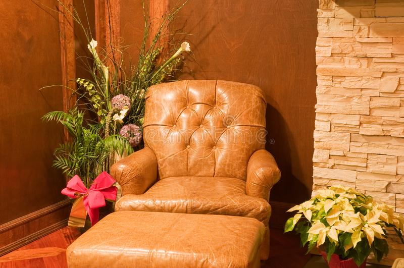 Comfortable old leather chair royalty free stock photography