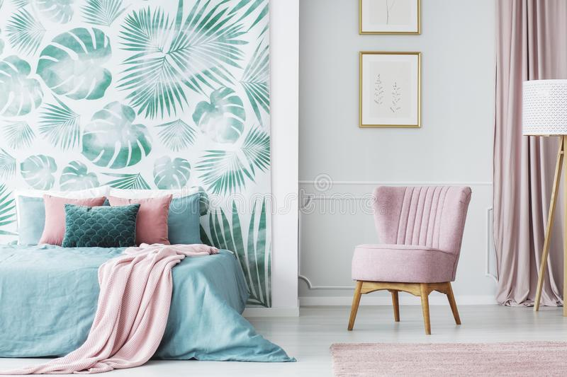 Comfortable pale pink upholstered chair royalty free stock photos